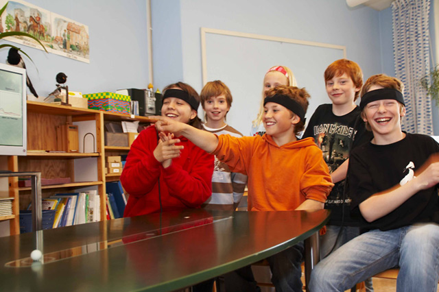 School kids playing Mindball game for Focus, Focus Game, Focus EEG, Focus Game EEG
